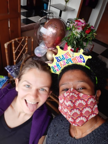 My Russian sister and I (She and her husband got me flowers and a mask)